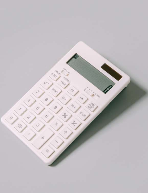 photo of a simple white calculator