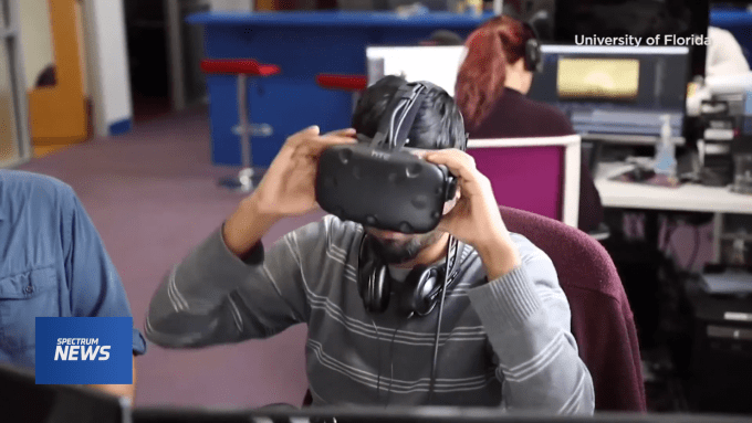 person placing a virtual reality headset over their eyes